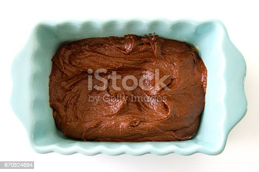 istock Brown chocolate cake batter in form ready for the oven 670524694