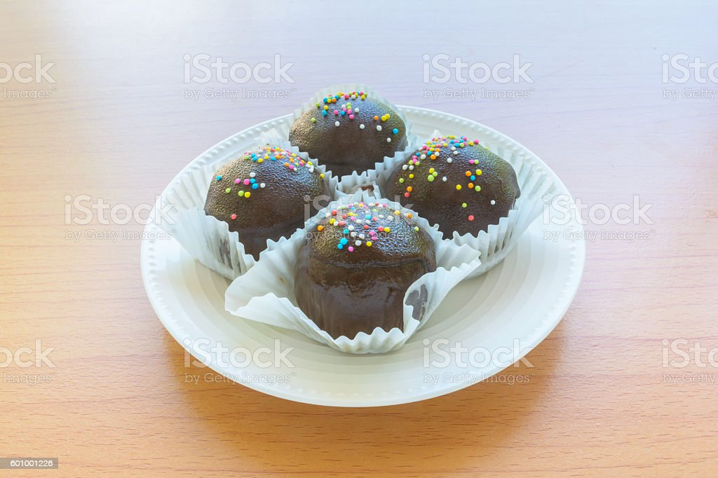 Brown chocolate on wooden table stock photo
