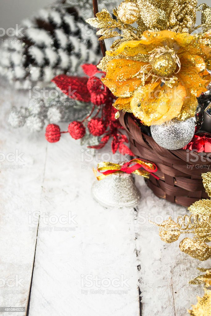 Brown Christmas basket with silver and gold toys stock photo