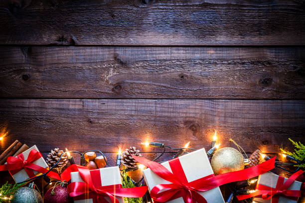 Brown christmas presents on rustic wooden table shot from above picture id1036313488?b=1&k=6&m=1036313488&s=612x612&w=0&h=tl1lebxqx7t61vg tzuzbegw te31ysy845n3jsvtv0=
