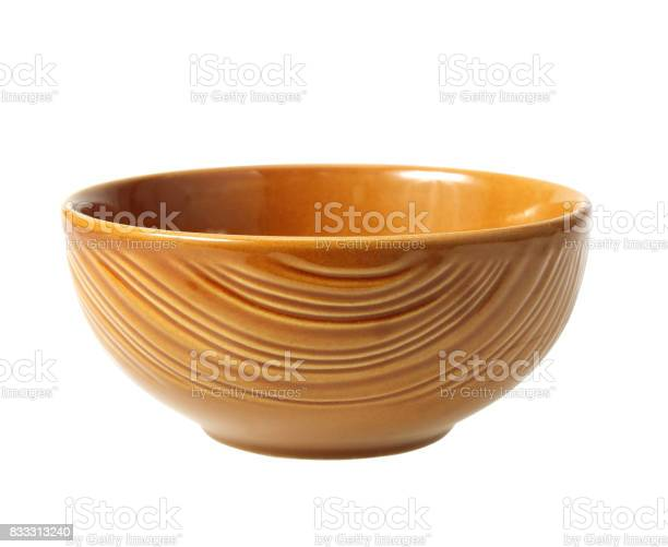 brown clay bowl isolated on white