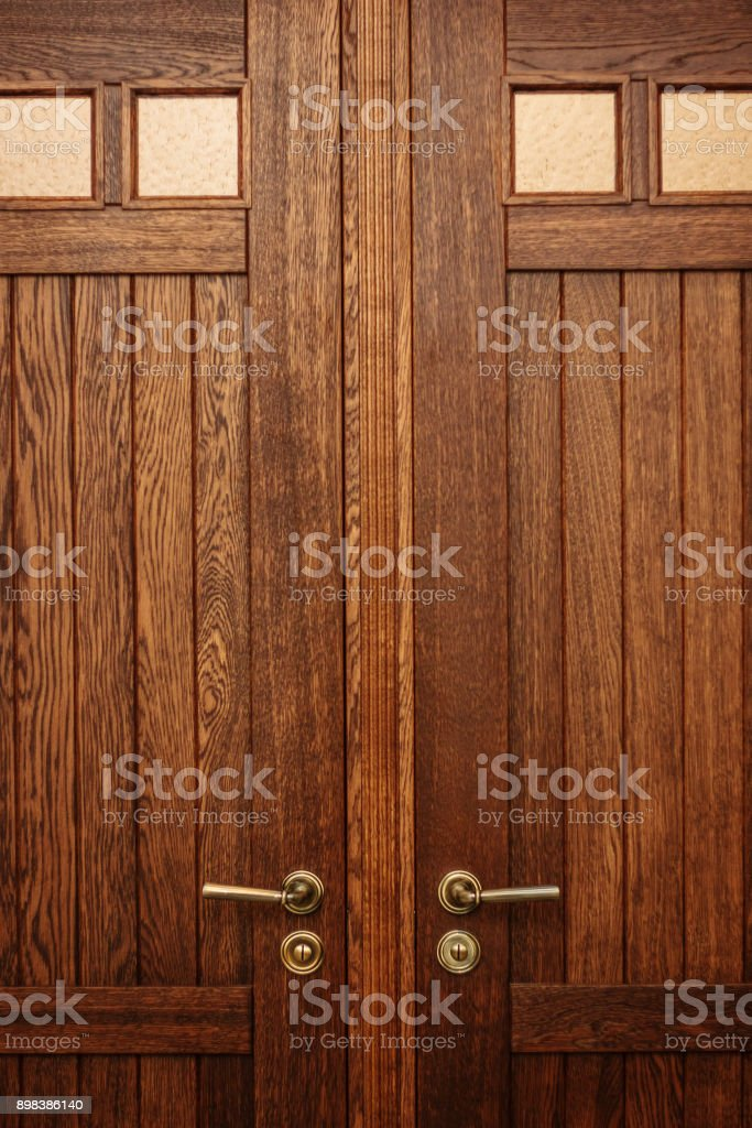 Brown closed door in modern house or hotel. stock photo