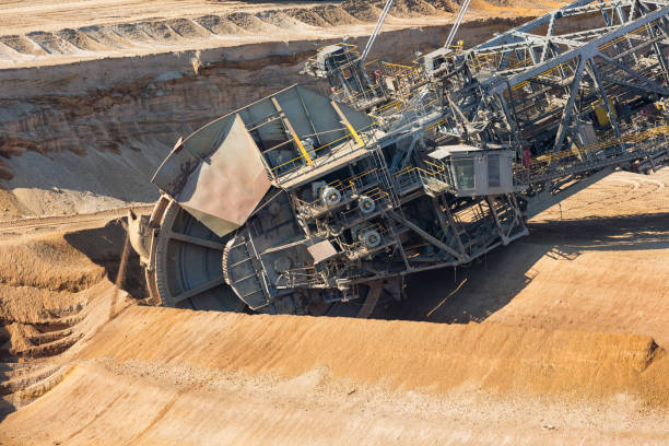 Brown coal open pit landscape with digging excavators in Germany Brown coal open pit landscape with enormous digging excavator in Hambach mine Germany, This machine is the biggest vehicle in the world tagebau stock pictures, royalty-free photos & images