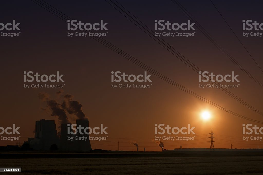 Brown coal power plant at sunset stock photo