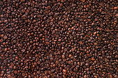 Brown Coffee Beans Background. Close Up.