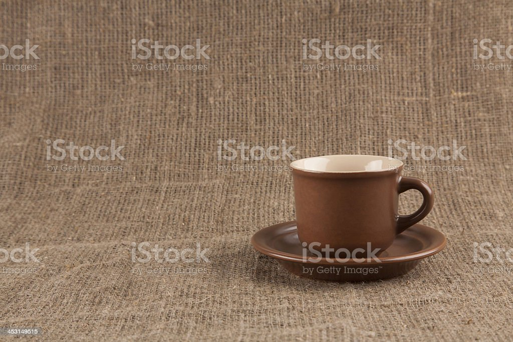 Brown coffee cup  on burlap royalty-free stock photo