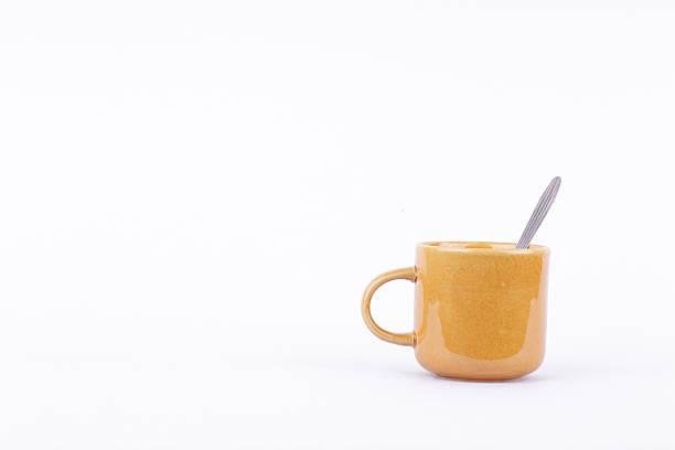 brown coffee or tea or milk mug cup and spoon – Foto