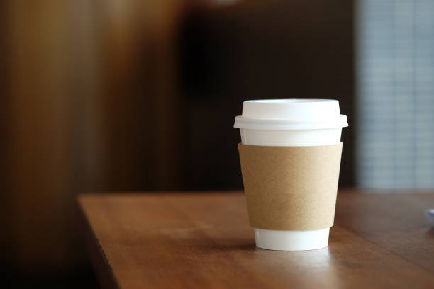 brown coffee paper cup. - paper coffee cup stock photos and pictures