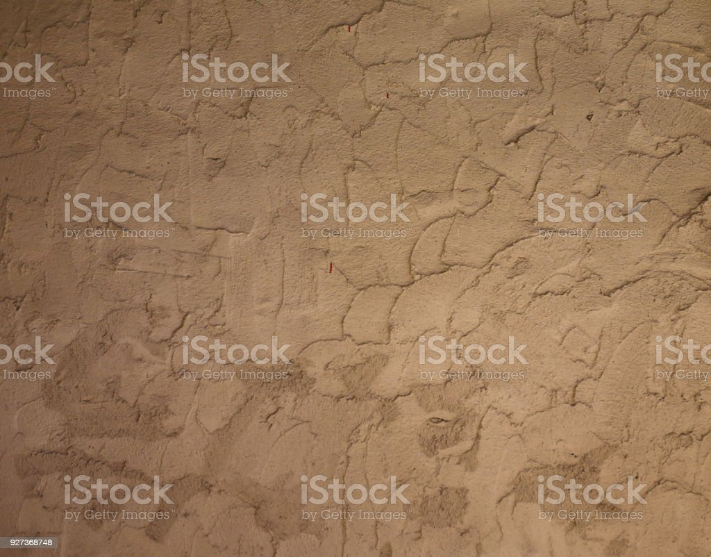 brown color bare concrete wall texture background with many war bullet holes - Royalty-free Abstract Stock Photo