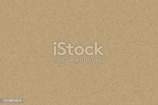 865741954 istock photo Brown color paper shown grain details on  it surface. 1212911572