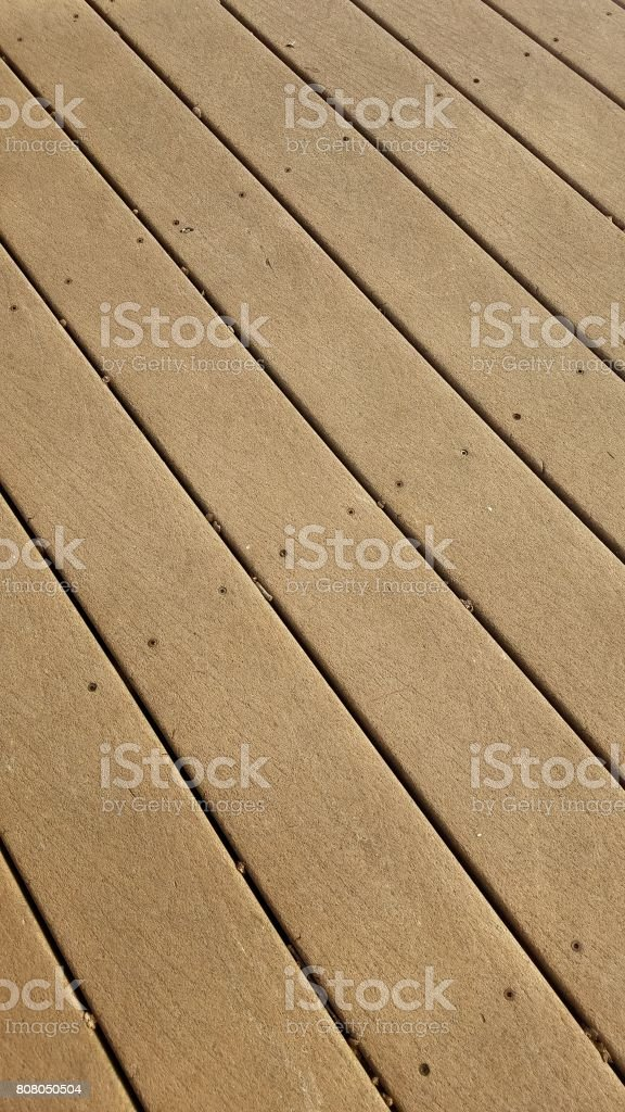 brown composite wood deck stock photo