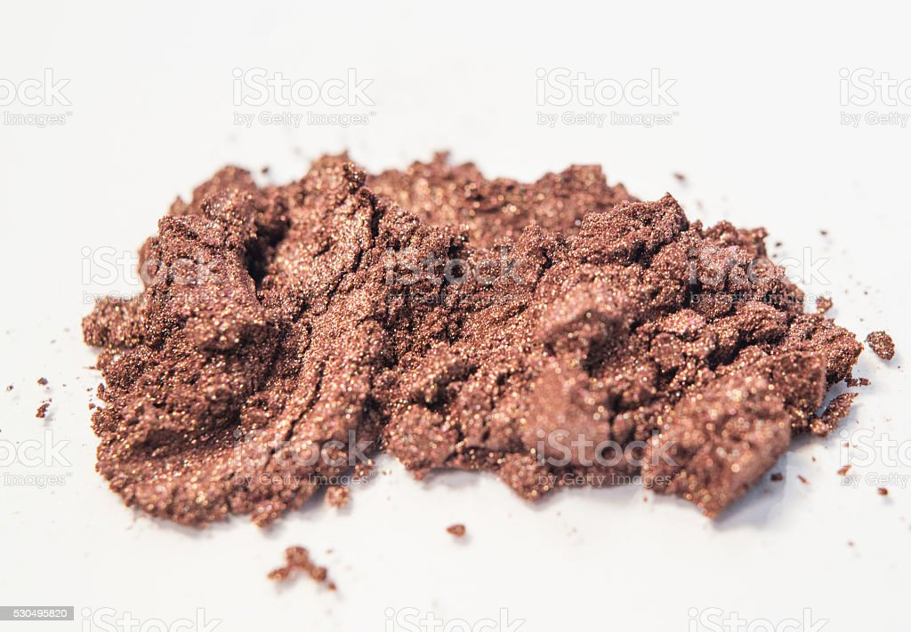 brown copper pink gold shimmer loose makeup powder stock photo