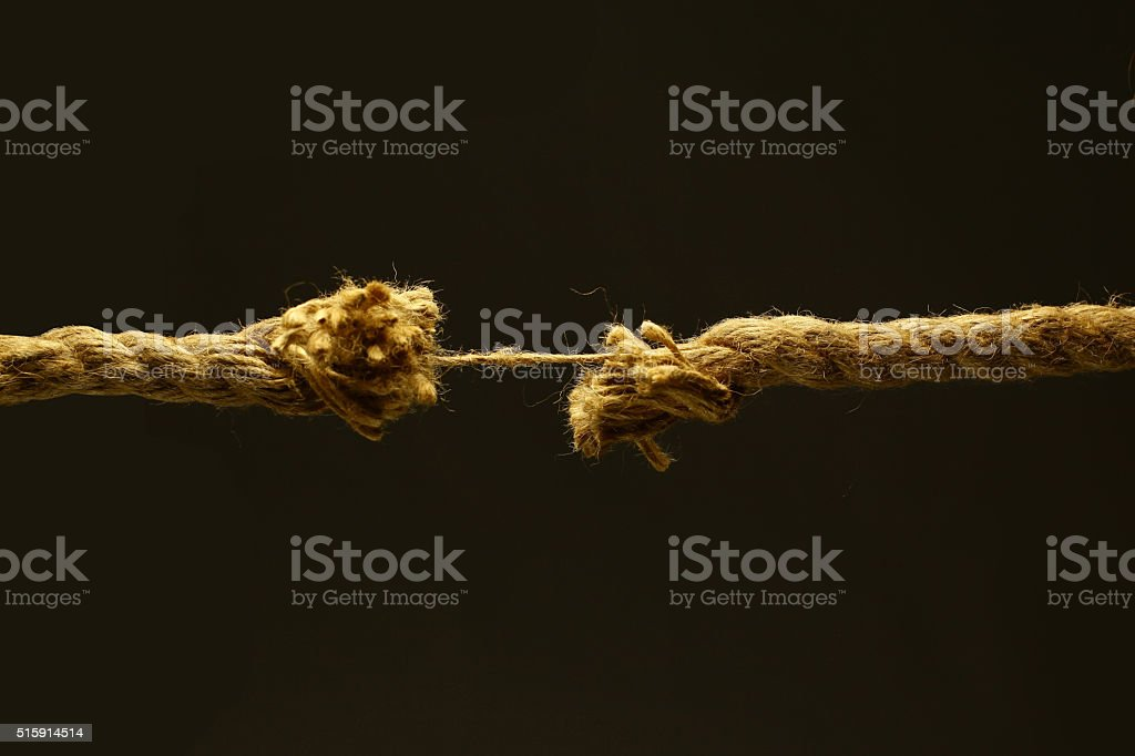 Brown cord on a black background stock photo