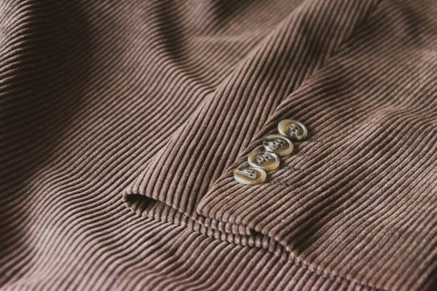 brown corduroy sleeve jacket with four buttons - corduroy stock pictures, royalty-free photos & images