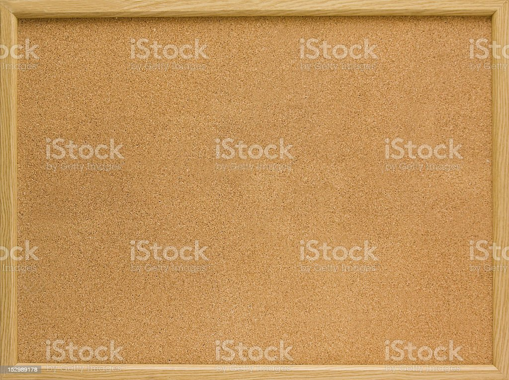 Brown cork board with thin wooden frame stock photo