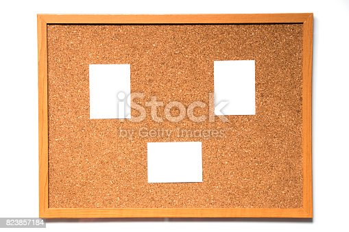 990092558 istock photo Brown cork board with wood frame and have paper to note attachment on white background 823857184