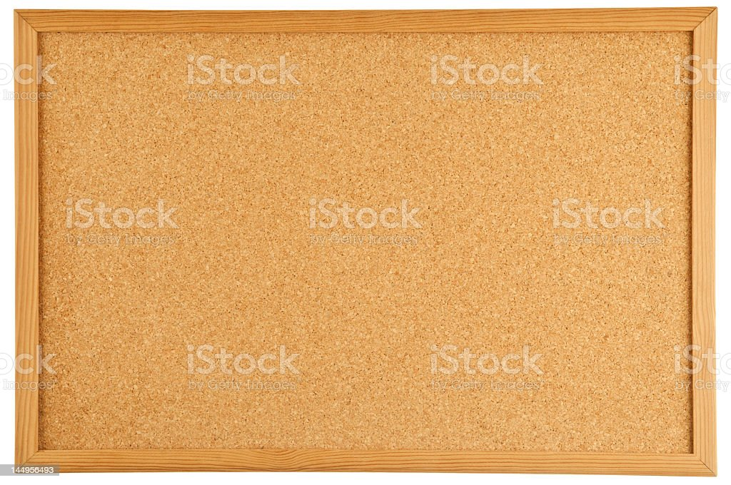 A brown cork bulletin board with a wooden frame stock photo