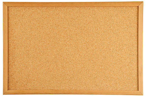 a brown cork bulletin board with a wooden frame - bulletin board stock pictures, royalty-free photos & images