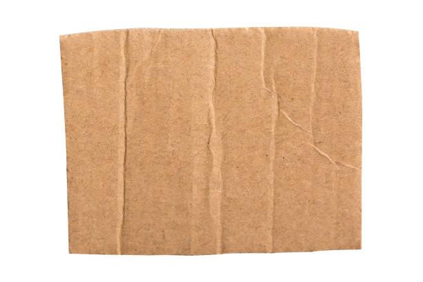 bruin gegolfd karton gescheurd stuk geïsoleerd op witte achtergrond. - bordpapier stockfoto's en -beelden