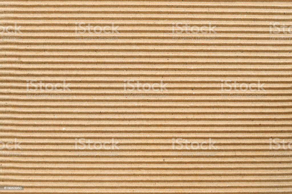 Brown corrugated cardboard useful as a background stock photo