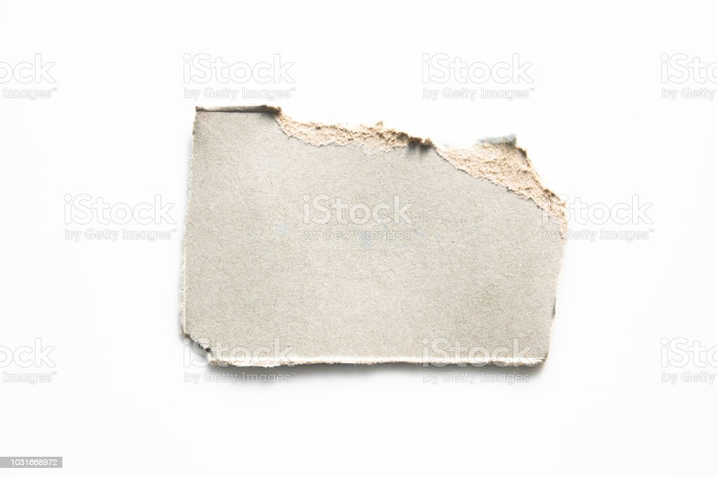 Brown corrugated texture paper torn on white background. rip of cardboard sheet used as a background . stock photo