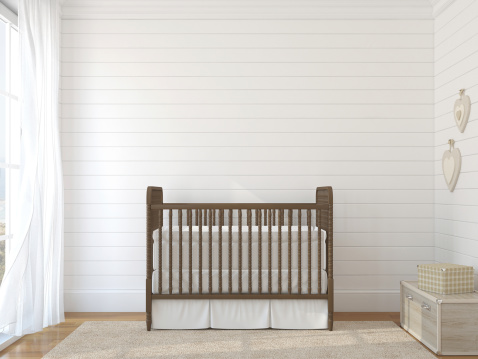 Brown Crib Against White Brick Wall Near Window Stock Photo - Download Image Now