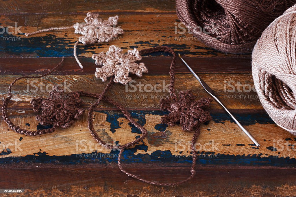Brown crochet snowflakes for Christmas decoration stock photo