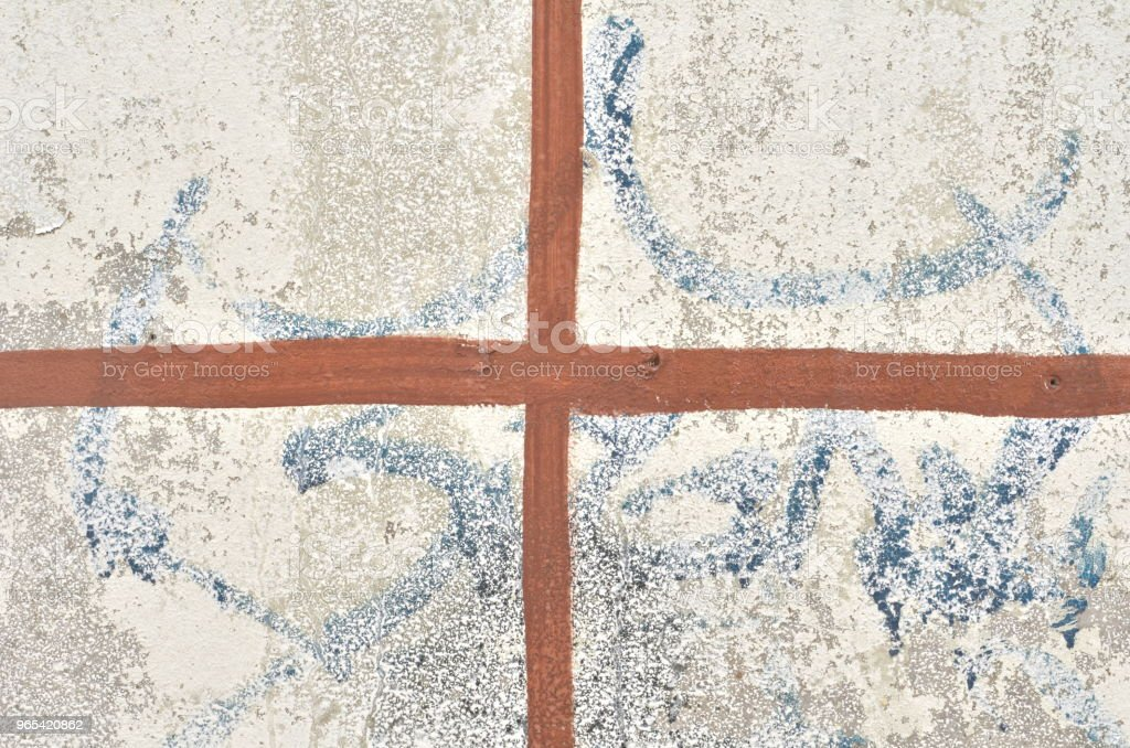 Brown cross on white background royalty-free stock photo