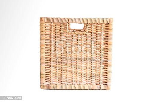 Brown cubic woven storage basket isolated on white front view.