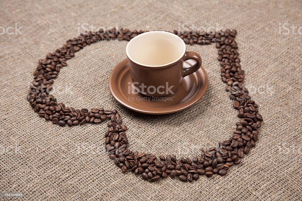 Brown cup of on burlap with coffee heart royalty-free stock photo
