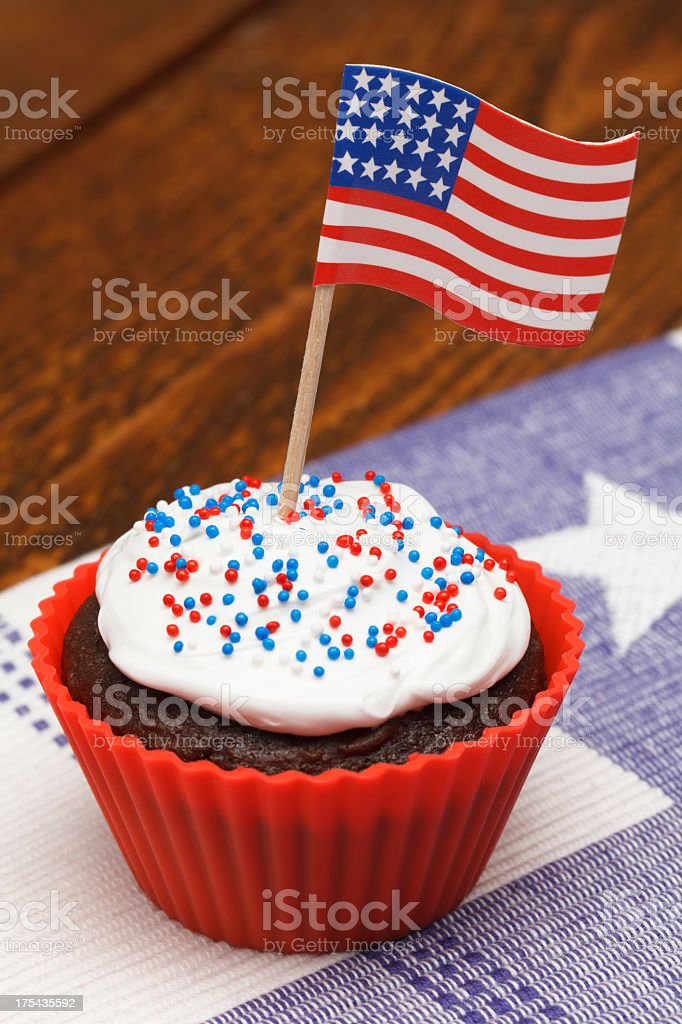 A brown cupcake has an American flag rising out of the icing royalty-free stock photo