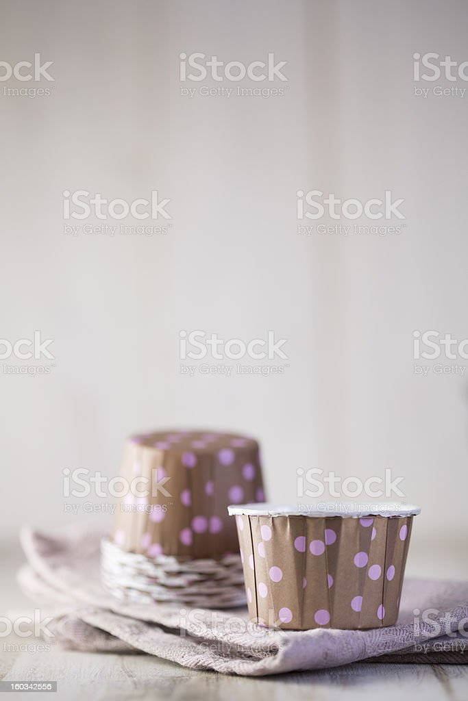 Brown cupcake liners with violet polka dot stock photo