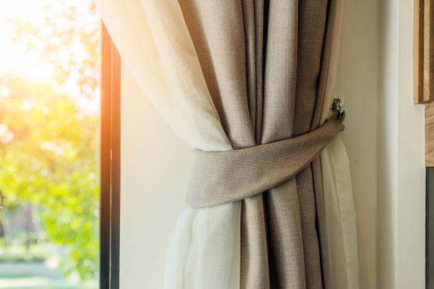 brown curtain with beautiful sun light and shadow - curtain stock pictures, royalty-free photos & images