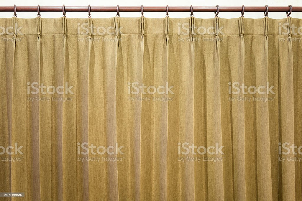 Brown curtains hang on the curtain rail. royalty-free stock photo