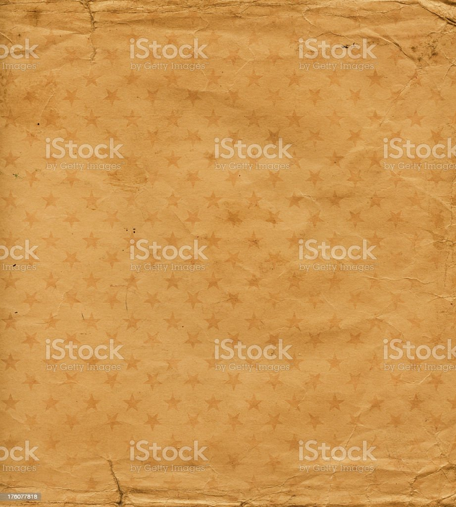brown damaged paper with stars royalty-free stock photo
