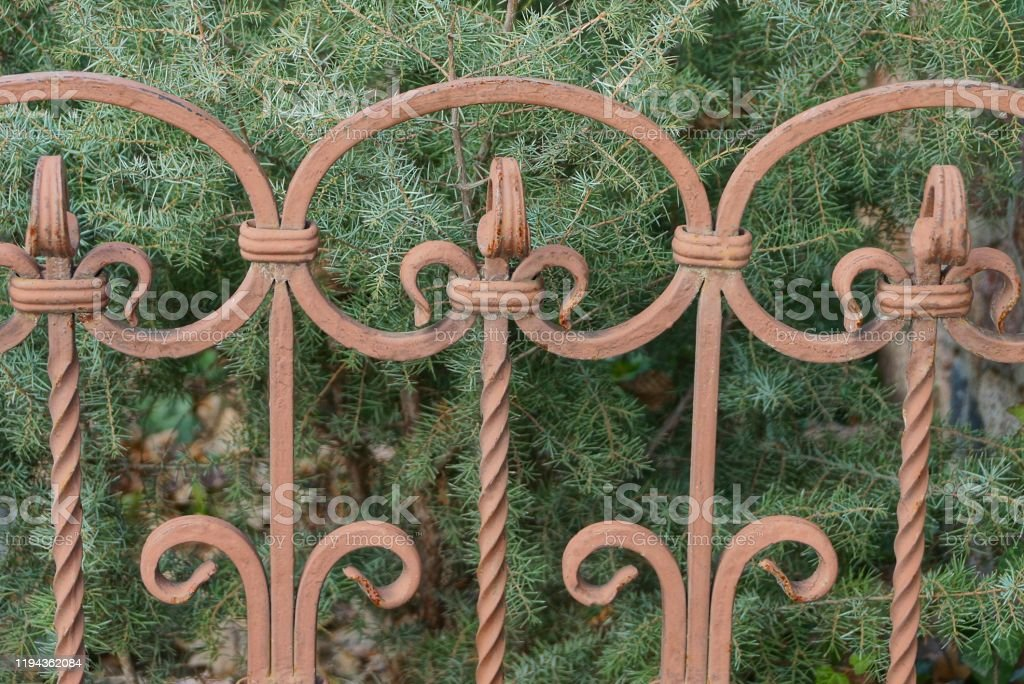 Picture of: Brown Decorative Fence Of Iron Rods In A Forged Pattern Stock Photo Download Image Now Istock