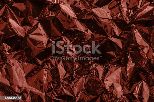 istock Brown deformed background made of tinted foil 1158338548