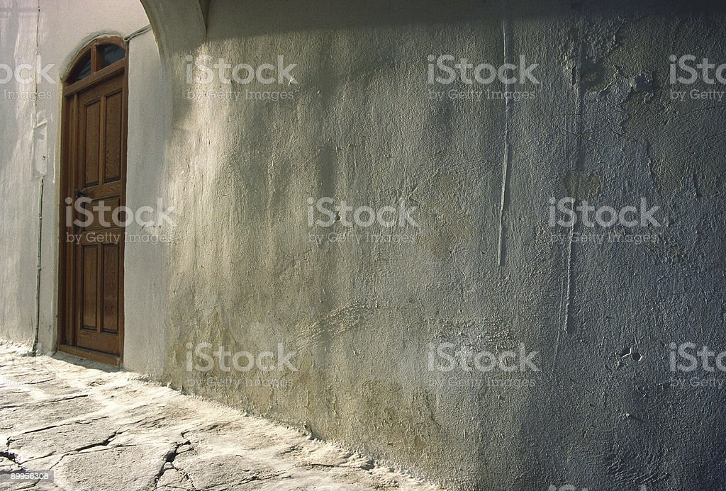 Brown Door, Weathered Wall, Paros, Greece stock photo