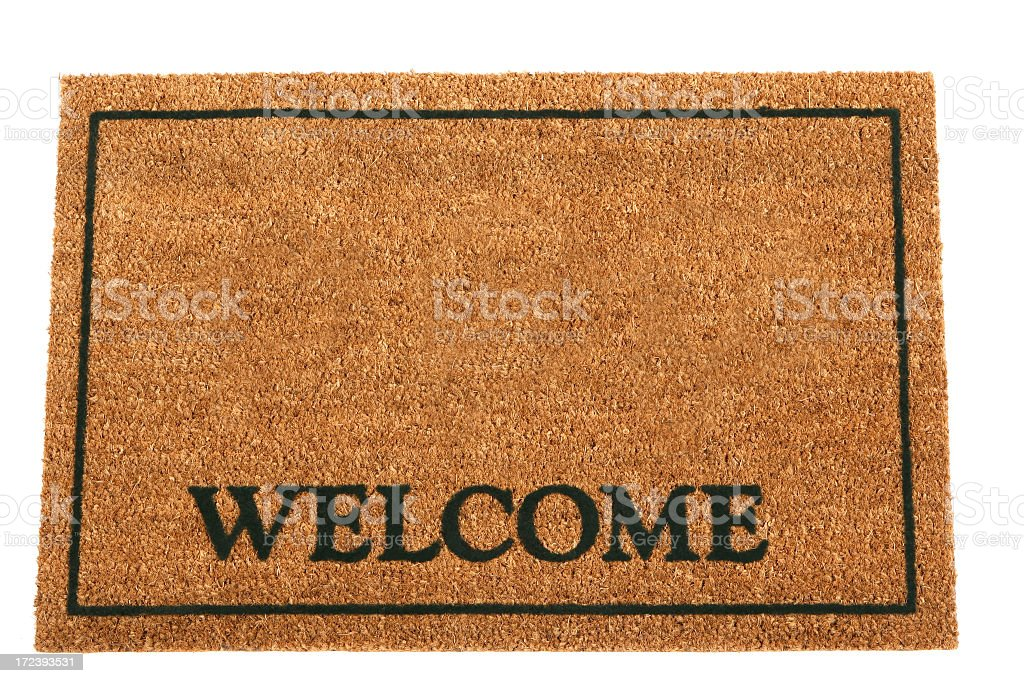 Brown doormat with Welcome and a rectangular frame stock photo