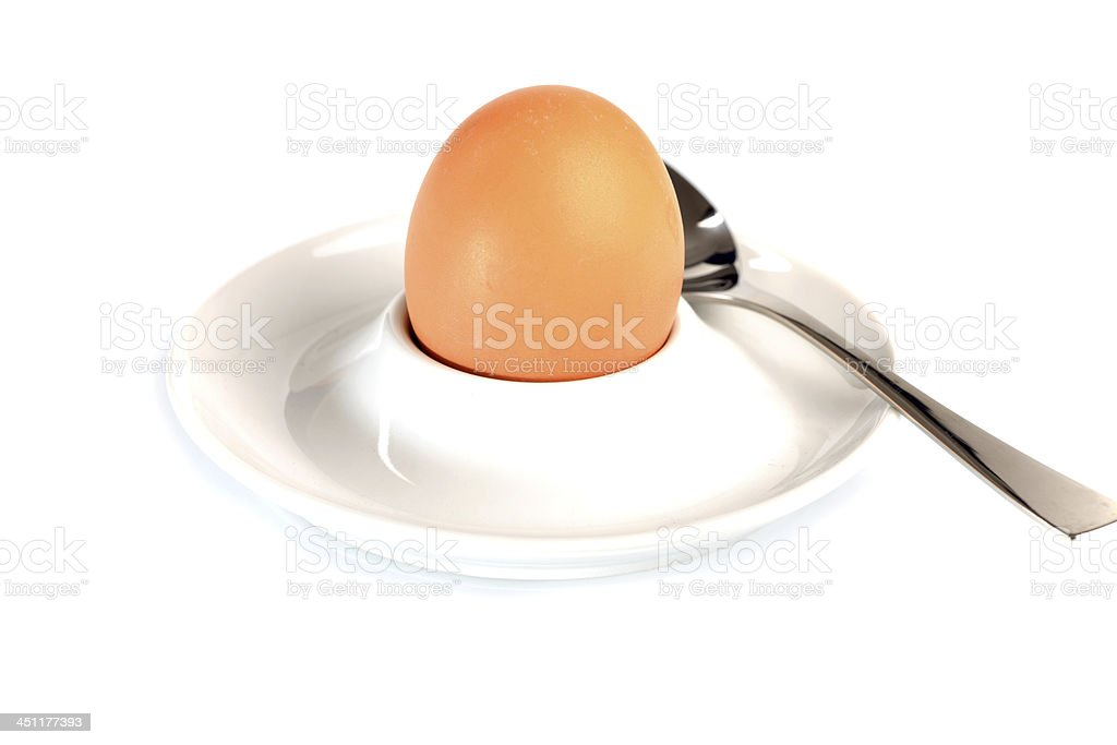 Brown egg in an a Eggcup stock photo