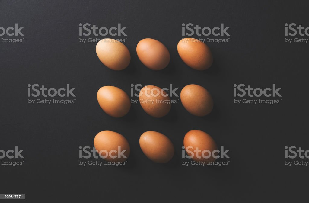 Brown eggs flat lay on black background stock photo