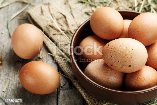 Brown eggs in a plate. Rural scene