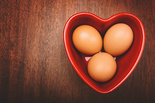 Brown Eggs in a Red Heart stock photo