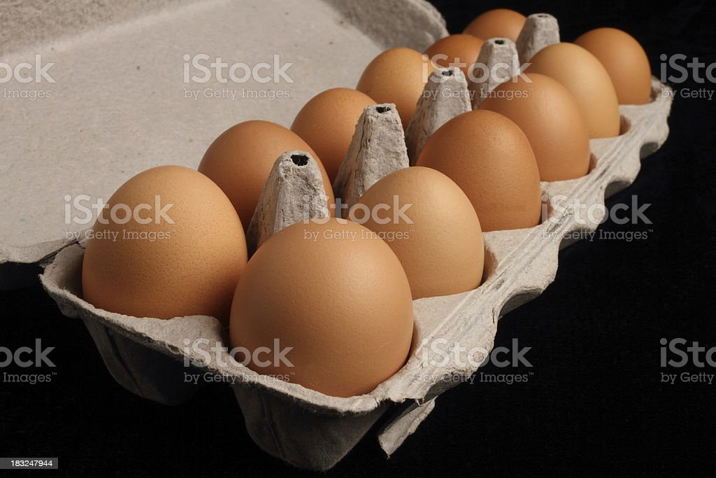 Brown Eggs in Carton on Black royalty-free stock photo