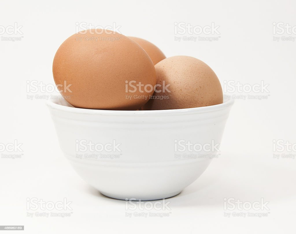 Brown Eggs in White Bowl royalty-free stock photo