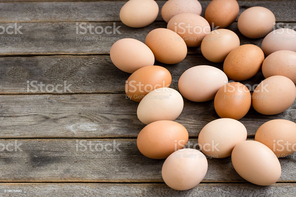 Brown eggs on the wooden grey table stock photo