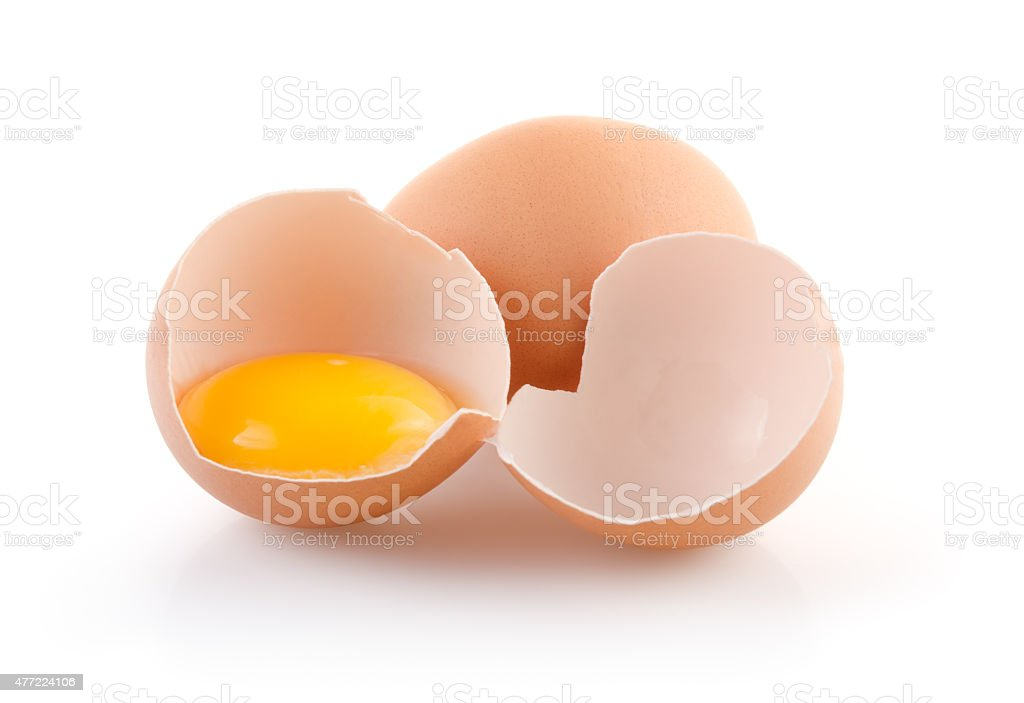 Brown Eggs, one broken stock photo