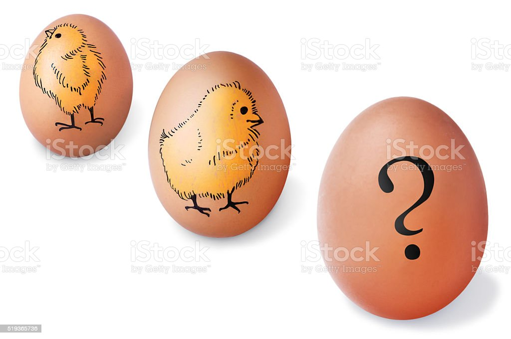 Brown eggs with painted chickens and question mark stock photo