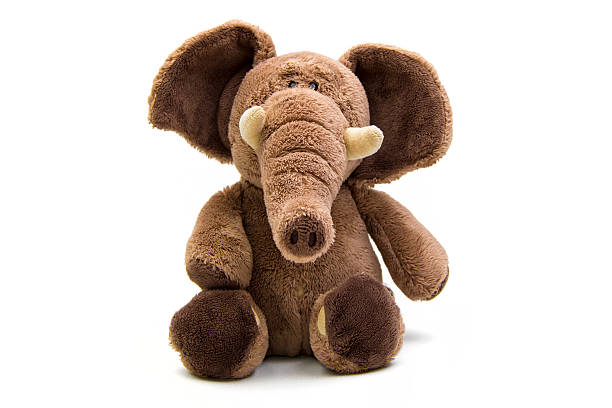 brown elephant soft toy isolated on white - kabarık stok fotoğraflar ve resimler