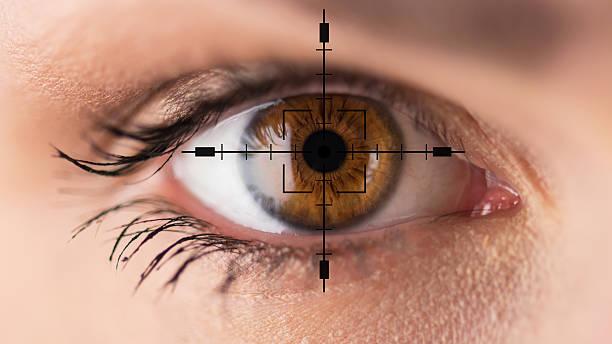 Brown eyes - eyesight test stock photo